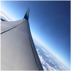 View of a plane wing in the sky
